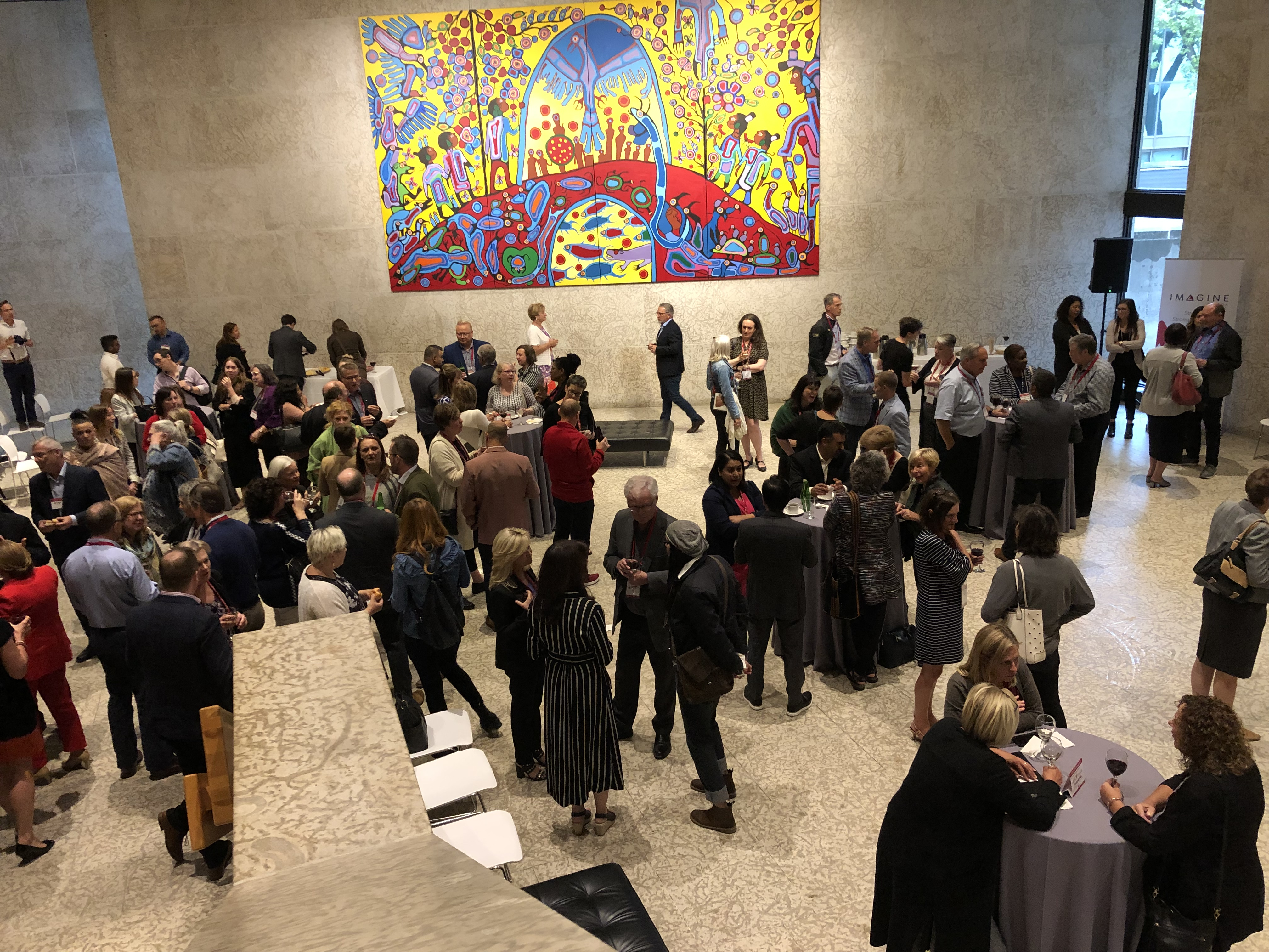 A group of people networking at the Winnipeg Art Gallery