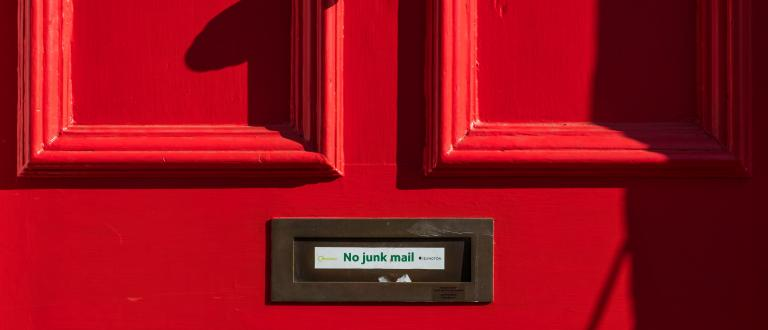 No junk mail sticker on red door